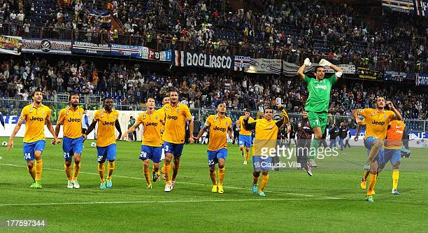 Juventus FC players celebrate victory at the end of the Serie A match between UC Sampdoria and Juventus at Stadio Luigi Ferraris on August 24 2013 in...