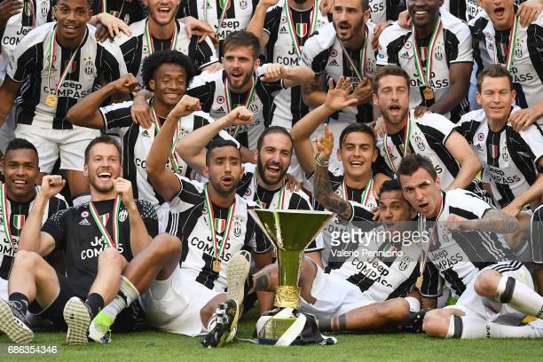 Juventus FC players celebrate with the trophy after the beating FC Crotone 30 to win the Serie A Championships at the end of the Serie A match...