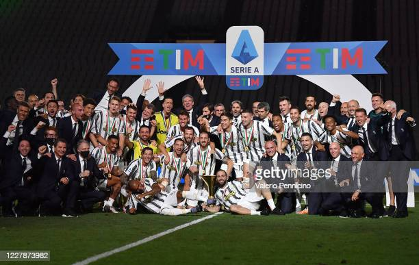 Juventus FC players celebrate with the trophy after the Serie A match between Juventus and AS Roma at Allianz Stadium on August 1 2020 in Turin Italy