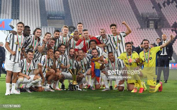 Juventus FC players celebrate with the trophy after winning the Serie A match between Juventus and AS Roma at Allianz Stadium on August 1, 2020 in...