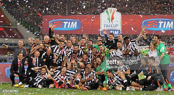 Juventus FC players celebrate with the trophy after winning the TIM Cup final match against SS Lazio at Olimpico Stadium on May 20, 2015 in Rome,...