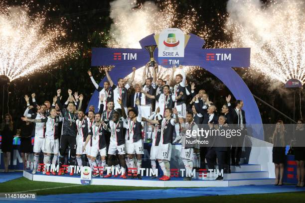 Juventus FC players lifts the trophy of Scudetto during the victory ceremony following the Italian Serie A last football match of the season Juventus...