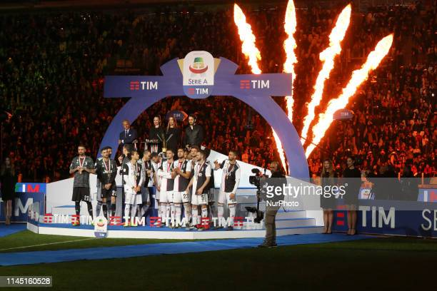 Juventus FC players with the trophy of Scudetto during the victory ceremony following the Italian Serie A last football match of the season Juventus...
