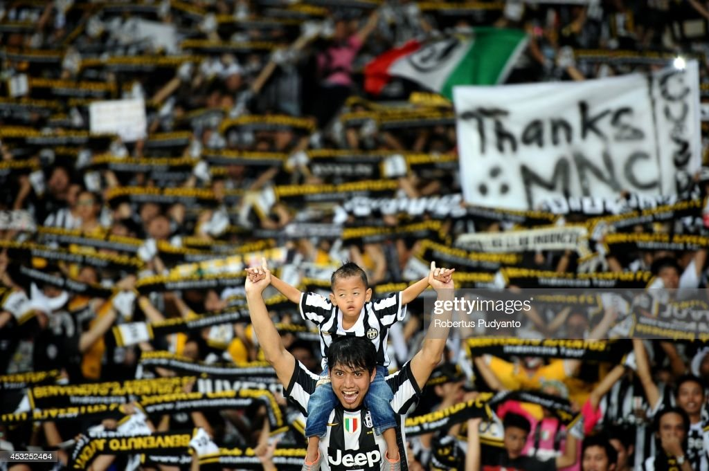 Juventus FC supporters show their support during the pre season friendly match between Indonesia Selection All Star Team and Juventus FC at Gelora Bung Karno Stadium on August 6, 2014 in Jakarta, Indonesia. Juventus FC win the game 8-1.