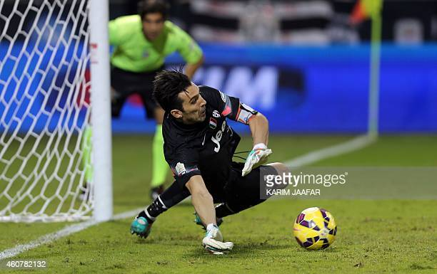 Juventus FC's Italian goalkeeper and captain Gianluigi Buffon dives to save a penalty shot during the Italian Super Cup against Napoli at the Sheikh...