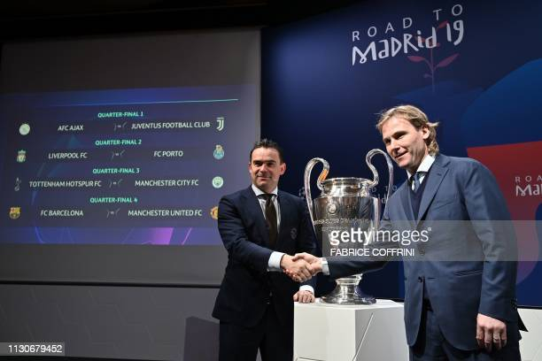 Juventus football club ambassador Pavel Nedved shakes hands with Ajax director of football Marc Overmars next to results of the draw for the...
