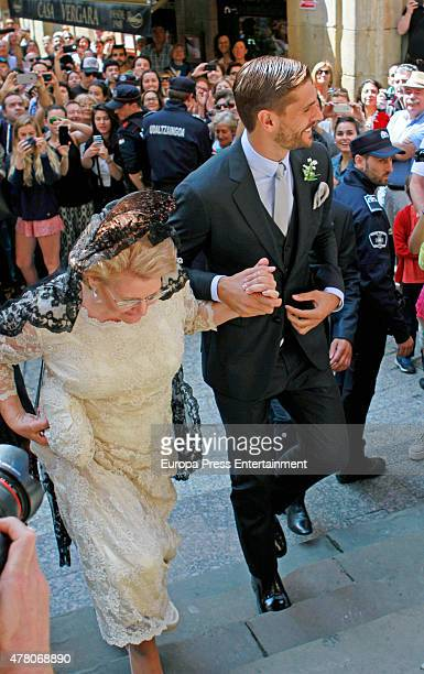 Juventus football player Fernando Llorente and his mother Isabel Torres attend his wedding with Maria Lorente at Santa Maria del Coro Basilica on...