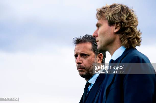 Juventus' former player Pavel Nedved looks on next to Juventus' sporting director Fabio Paratici during the Italian Serie A football match between...