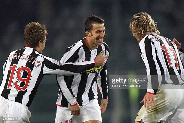 Juventus' forward Alessandro Del Piero celebrates after scoring with teammates Domenico Criscito and Pavel Nedved during their Serie A match at...
