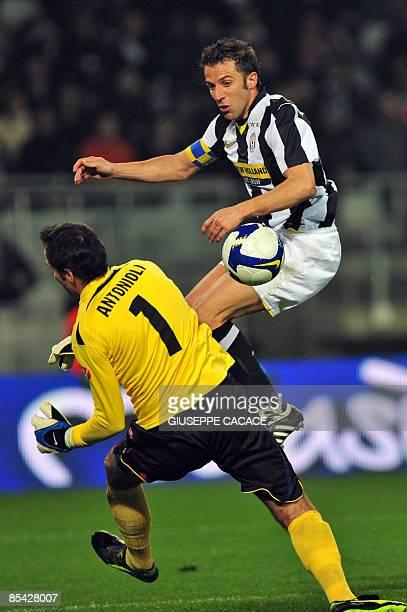 Juventus' forward Alessandro Del Piero vies for the ball with Bologna's goalkeeper Francesco Antonioli during their Serie A football match Juventus...