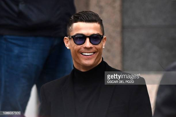 Juventus' forward and former Real Madrid player Cristiano Ronaldo smiles as he leaves after attending a court hearing for tax evasion in Madrid on...