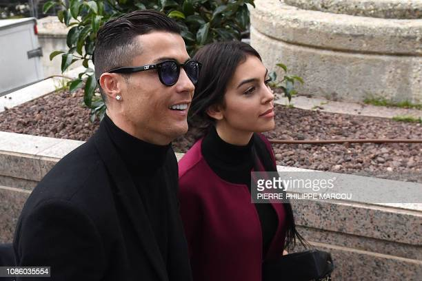 Juventus' forward and former Real Madrid player Cristiano Ronaldo arrives with his Spanish girlfriend Georgina Rodriguez to attend a court hearing...
