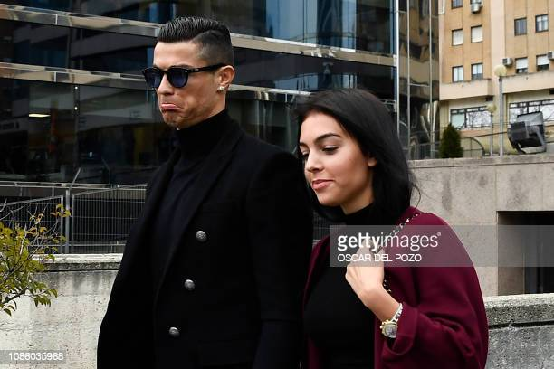Juventus' forward and former Real Madrid player Cristiano Ronaldo leaves with his Spanish girlfriend Georgina Rodriguez after attending a court...