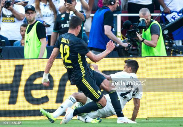 Juventus forward Andrea Favilli tackles Real Madrid midfielder Sergio Reguilon during an International Champions Cup match between Juventus and Real...
