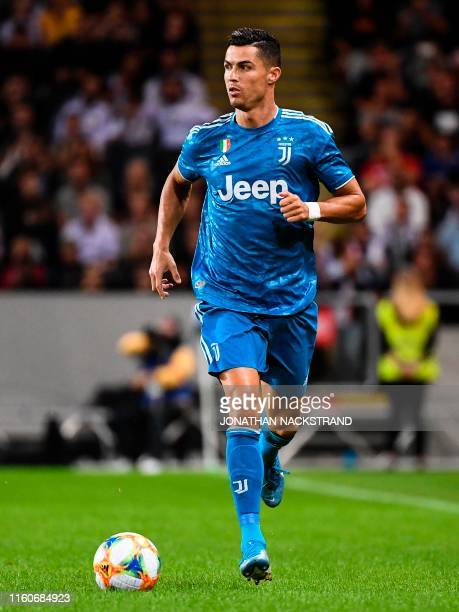Juventus' forward Cristiano Ronaldo controls the ball during the International Champions Cup football match between Atletico Madrid v Juventus on...