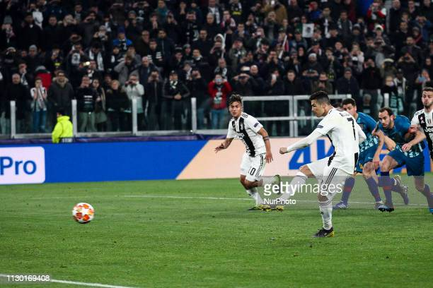 Juventus forward Cristiano Ronaldo scores his goal by penalty kick during the Uefa Champions League Round of 16 football match JUVENTUS ATLETICO...
