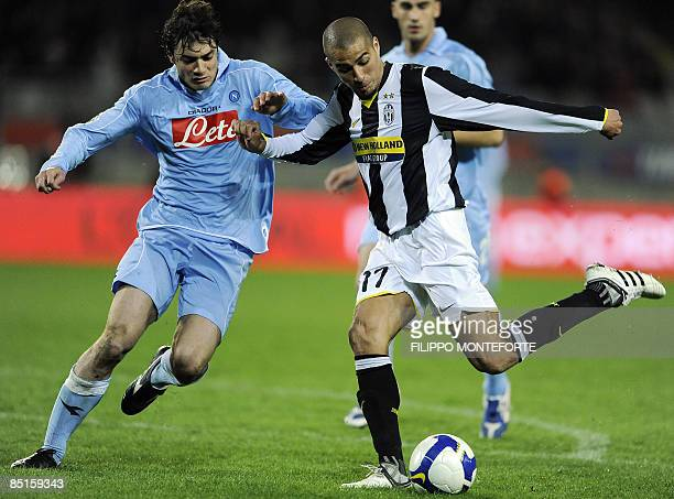 Juventus' forward David Trezeguet of France tries to shoot the ball past Napoli's Matteo Contini during their Series A football match at Turin's...