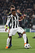 juventus forward douglas costa fights for