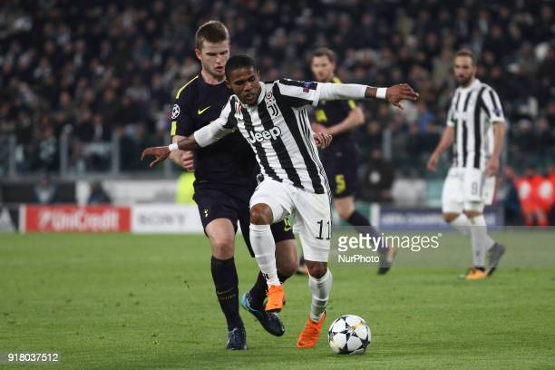 Juventus forward Douglas Costa fights for the ball against Tottenham defender Eric Dier during the Uefa Champions League round of 16 football match...