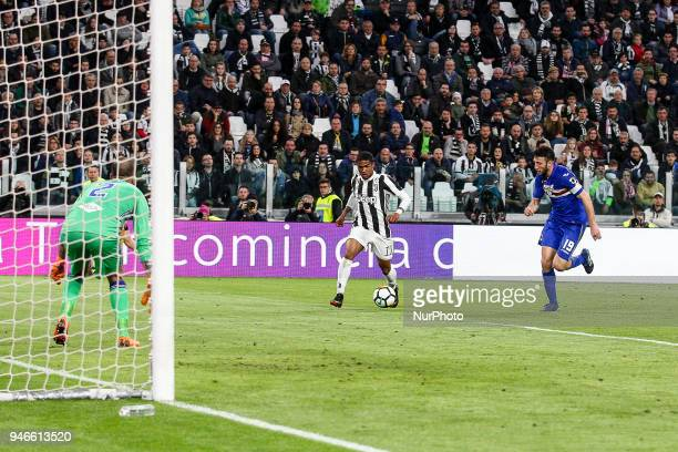 Juventus forward Douglas Costa passes the ball for the goal of Juventus midfielder Sami Khedira during the Serie A football match n32 Juventus FC and...