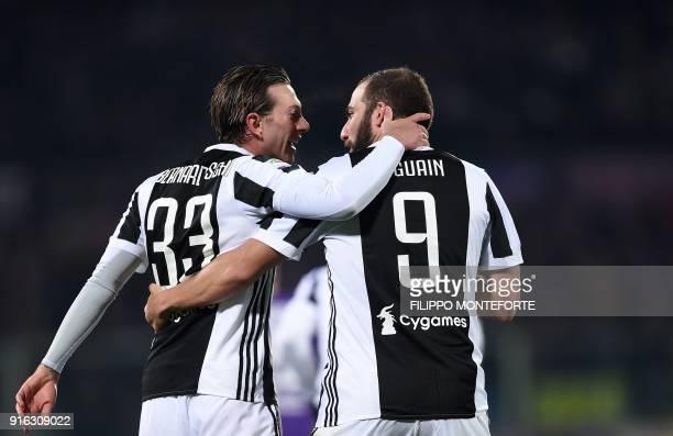Juventus' forward Federico Bernardeschi celebrates with teammate Juventus' FrenchArgentinian forward Gonzalo Higuain after scoring during the italian...