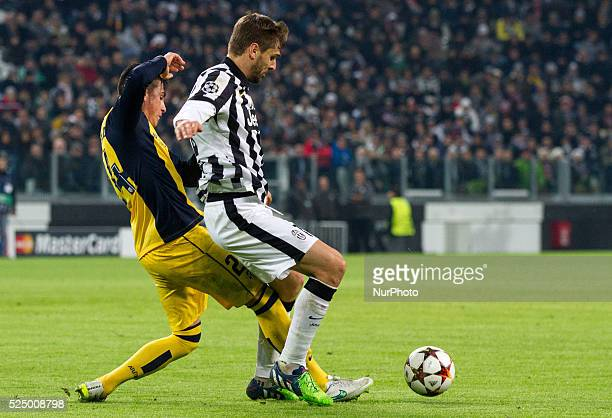 Juventus forward Fernando Llorente fights for the ball against Atletico Madrid defender Jose Gimenez during the Uefa Champions League Group Stage...