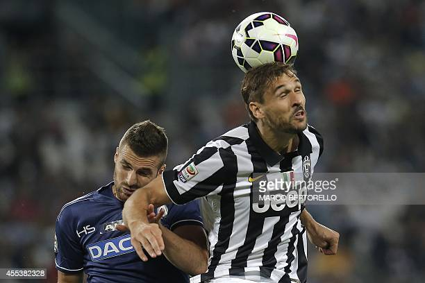 Juventus' forward Fernando Llorente heads the ball past Udinese's defender Igor Bubnjic during the Italian Serie A football match Juventus vs Udinese...