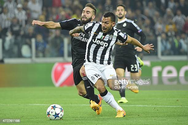 Juventus' forward from Argentina Carlos Tevez is tackled by Real Madrid's defender Dani Carvajal during the UEFA Champions League semifinal first leg...