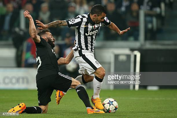 Juventus' forward from Argentina Carlos Tevez vies with Real Madrid's defender Dani Carvajal during the UEFA Champions League semifinal first leg...