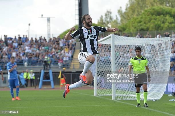 Juventus' forward from Argentina Gonzalo Gerardo Higuain celebrates after scoring during the Italian Serie A football match Empoli vs Juventus on...