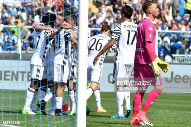 Juventus' forward from Argentina Gonzalo Gerardo Higuain celebrates after scoring during the Italian Serie A football match Pescara versus Juventus...