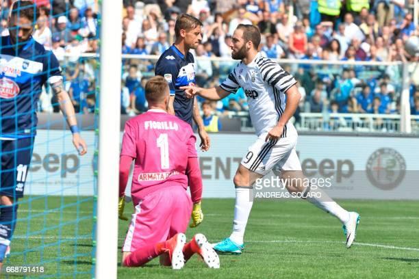 Juventus' forward from Argentina Gonzalo Gerardo Higuain celebrates after scoring against Pescara's goalkeeper Vincenzo Fiorillo during the Italian...