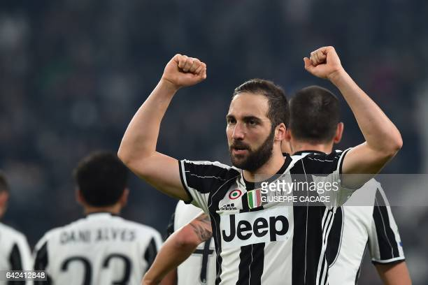 Juventus' forward from Argentina Gonzalo Higuain celebrates after scoring a goal during the Italian Serie A football match between Juventus and...