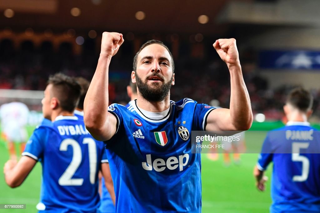 Juventus' forward from Argentina Gonzalo Higuain celebrates scoring a goal during the UEFA Champions League semi-final first leg football match Monaco vs Juventus at the Stade Louis II stadium in Monaco on May 3, 2017. /