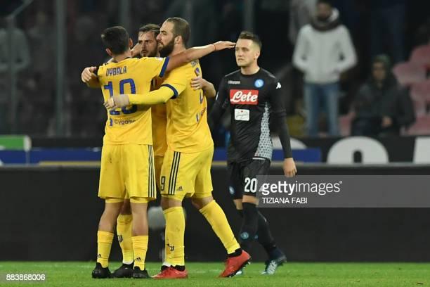Juventus' forward from Argentina Gonzalo Higuain celebrates with Juventus' forward from Argentina Paulo Dybala and Juventus midfielder Miralem Pjanic...