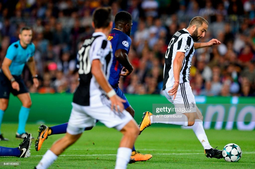 Juventus' forward from Argentina Gonzalo Higuain drives the ball during the UEFA Champions League Group D football match FC Barcelona vs Juventus at the Camp Nou stadium in Barcelona on September 12, 2017. / AFP PHOTO / Josep LAGO