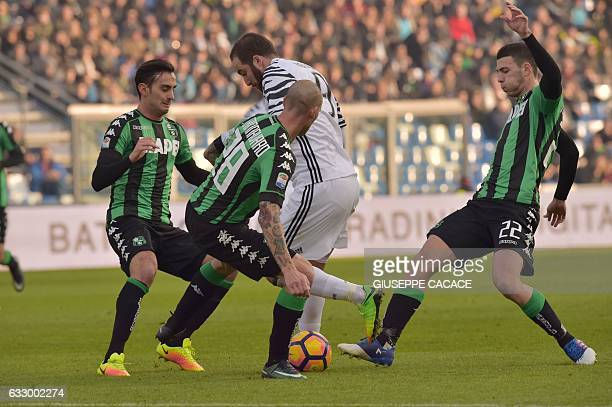 Juventus' forward from Argentina Gonzalo Higuain fights for the ball with Sassuolo's defender from Italy Leonardo Fontanesi Sassuolo's defender from...