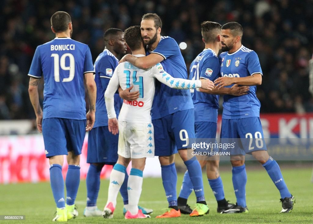 Juventus' forward from Argentina Gonzalo Higuain greets Napoli's Belgian forward Dries Mertens at the end of the Italian Serie A football match SSC Napoli vs Juventus FC on April 2, 2017 at the San Paolo Stadium. /