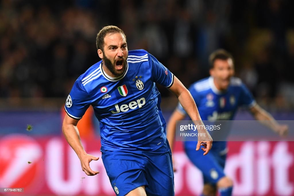 Juventus' forward from Argentina Gonzalo Higuain reacts after scoring a goal during the UEFA Champions League semi-final first leg football match Monaco vs Juventus at the Stade Louis II stadium in Monaco on May 3, 2017. /
