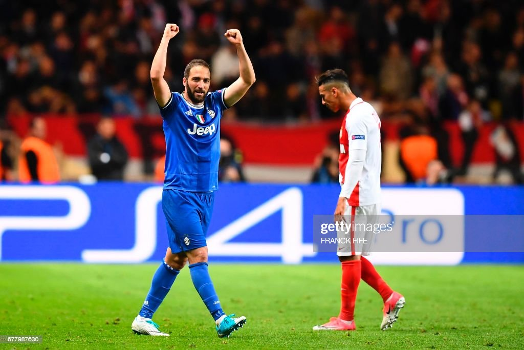 Juventus' forward from Argentina Gonzalo Higuain reacts after scoring the team's second goal during the UEFA Champions League semi-final first leg football match Monaco vs Juventus at the Stade Louis II stadium in Monaco on May 3, 2017. /