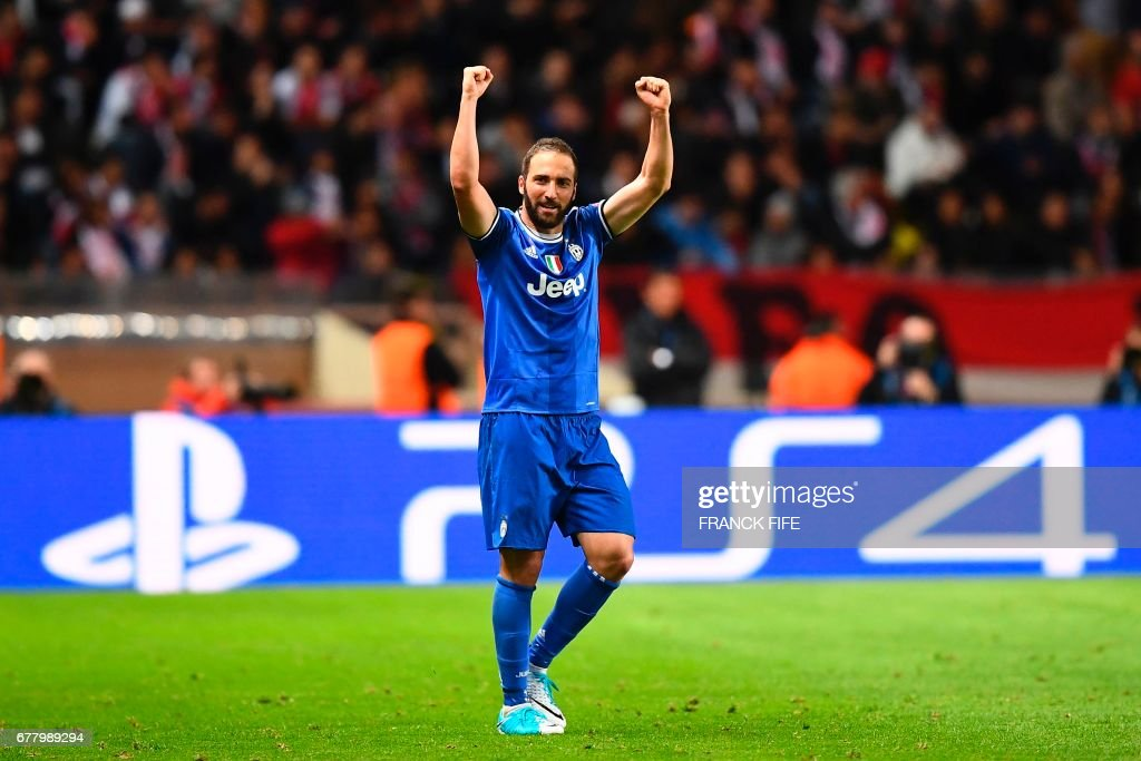 Juventus' forward from Argentina Gonzalo Higuain reacts after scoring his second goal during the UEFA Champions League semi-final first leg football match Monaco vs Juventus at the Stade Louis II stadium in Monaco on May 3, 2017. /