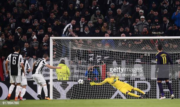 Juventus' forward from Argentina Gonzalo Higuain scores a penalty past Tottenham Hotspur's French goalkeeper Hugo Lloris during the UEFA Champions...