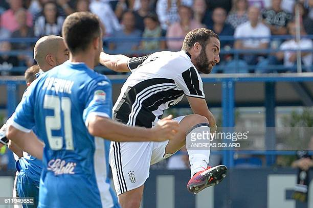 Juventus' forward from Argentina Gonzalo Higuain scores during the Italian Serie A football match Empoli vs Juventus on October 2 2016 at Empoli's...