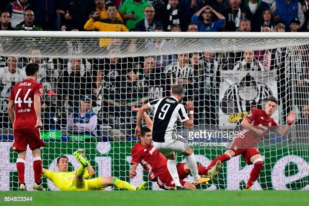Juventus' forward from Argentina Gonzalo Higuain scores during the UEFA Champion's League Group D football match Juventus vs Olympiacos on September...