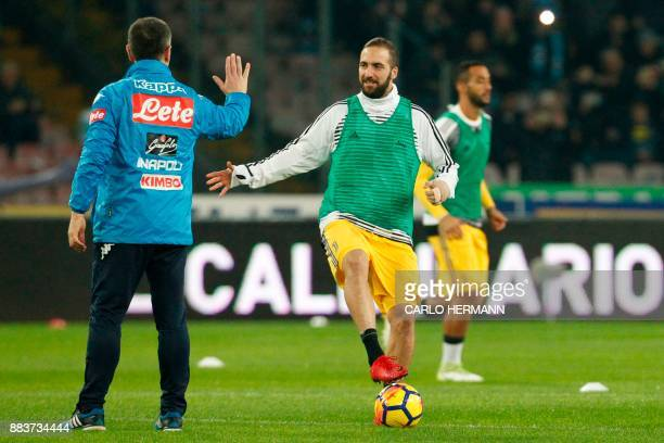 Juventus' forward from Argentina Gonzalo Higuain warms up before the Italian Serie A football match Napoli vs Juventus on December 1 2017 at the San...