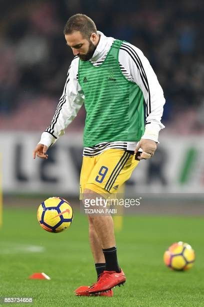 Juventus' forward from Argentina Gonzalo Higuain warms up with a bandaged hand before the Italian Serie A football match Napoli vs Juventus on...