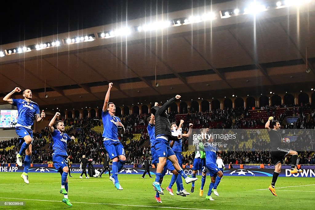 Juventus' forward from Argentina Gonzalo Higuain (black jacket) who scored 2 goals celebrates with team mates their 2-0 win over Monaco during the UEFA Champions League semi-final first leg football match Monaco vs Juventus at the Stade Louis II stadium in Monaco on May 3, 2017. /