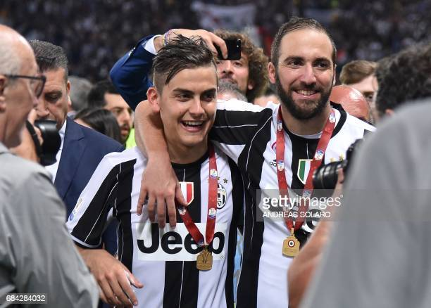 Juventus' forward from Argentina Paulo Dybala and Juventus' forward from Argentina Gonzalo Higuain celebrate after winning the Italian Tim Cup final...
