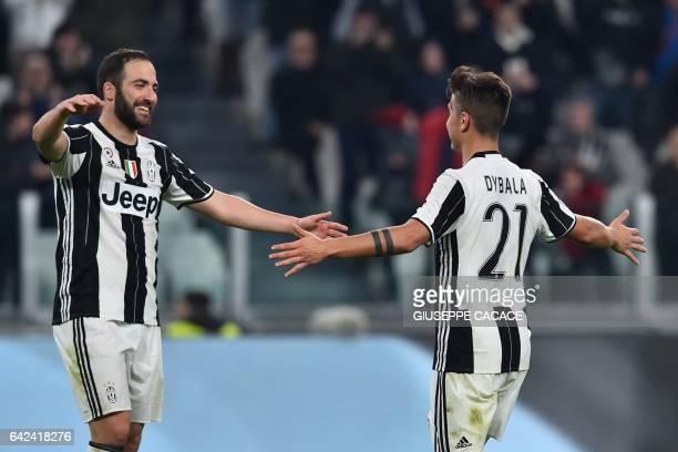 Juventus' forward from Argentina Paulo Dybala celebrates after scoring a goal with Juventus' forward from Argentina Gonzalo Higuain during the...