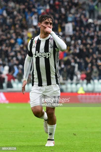 Juventus' forward from Argentina Paulo Dybala celebrates after scoring during the Italian Serie A football match Juventus vs Udinese on March 11 2018...